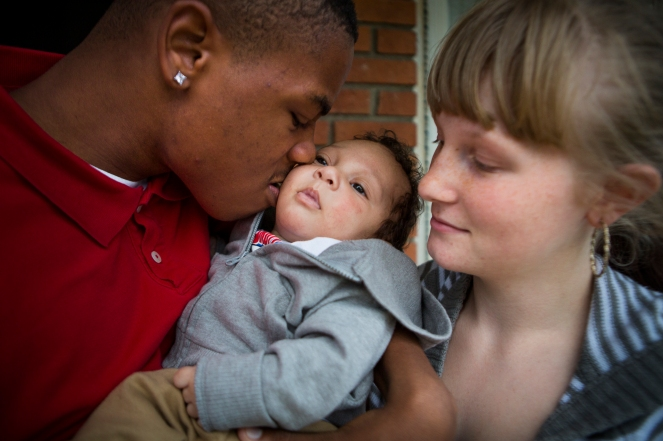 Brittney and Dom hold their son, Dylon, now two and half months old on October 3, 2014 in Rochester, NY.