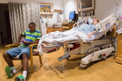 Brittney and her boyfriend, Dom, use their smart phones at Unity Hospital in Rochester, NY on July 21, 2014.