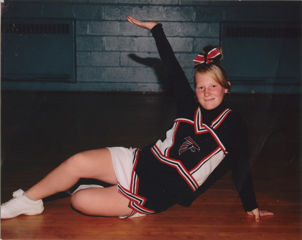 This undated family photo shows Brittney in her cheerleading uniform. Brittney still coaches youth cheerleading and is part of a nationally ranked cheerleading team in Rochester despite being a young mother.